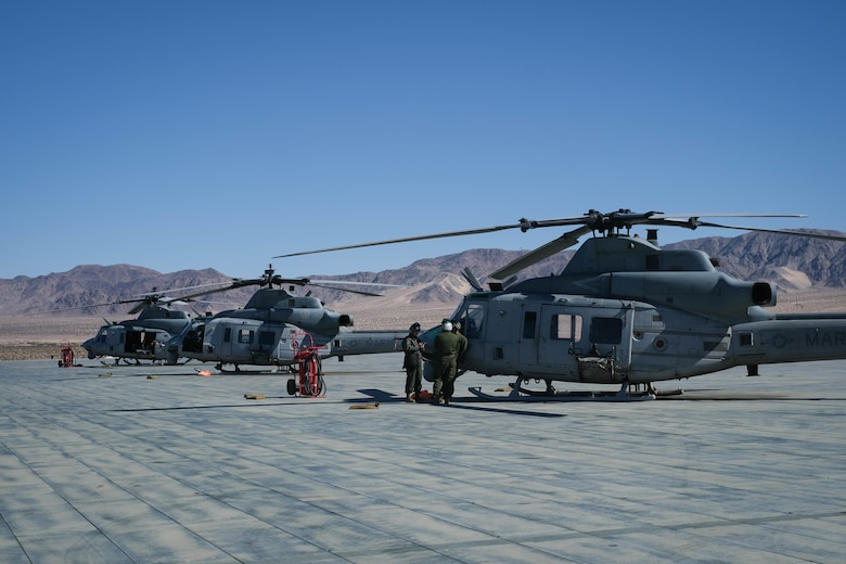 A U.S. Marine Corps Bell UH-1Y Venom utility helicopter awaits utilization during MAGTF Warfighting Exercise 2-21 on Marine Corps Air Ground Combat Center, Twentynine Palms, California, February 18, 2021. MWX is a force on force exercise designed to challenge the MAGTF, other U.S. forces, and allied nations' militaries against a peer adversary in a free play environment in order to assist forces with meeting current and future real world operational demands. (U.S. Marine Corps photo by Lance Cpl. Therese Edwards)