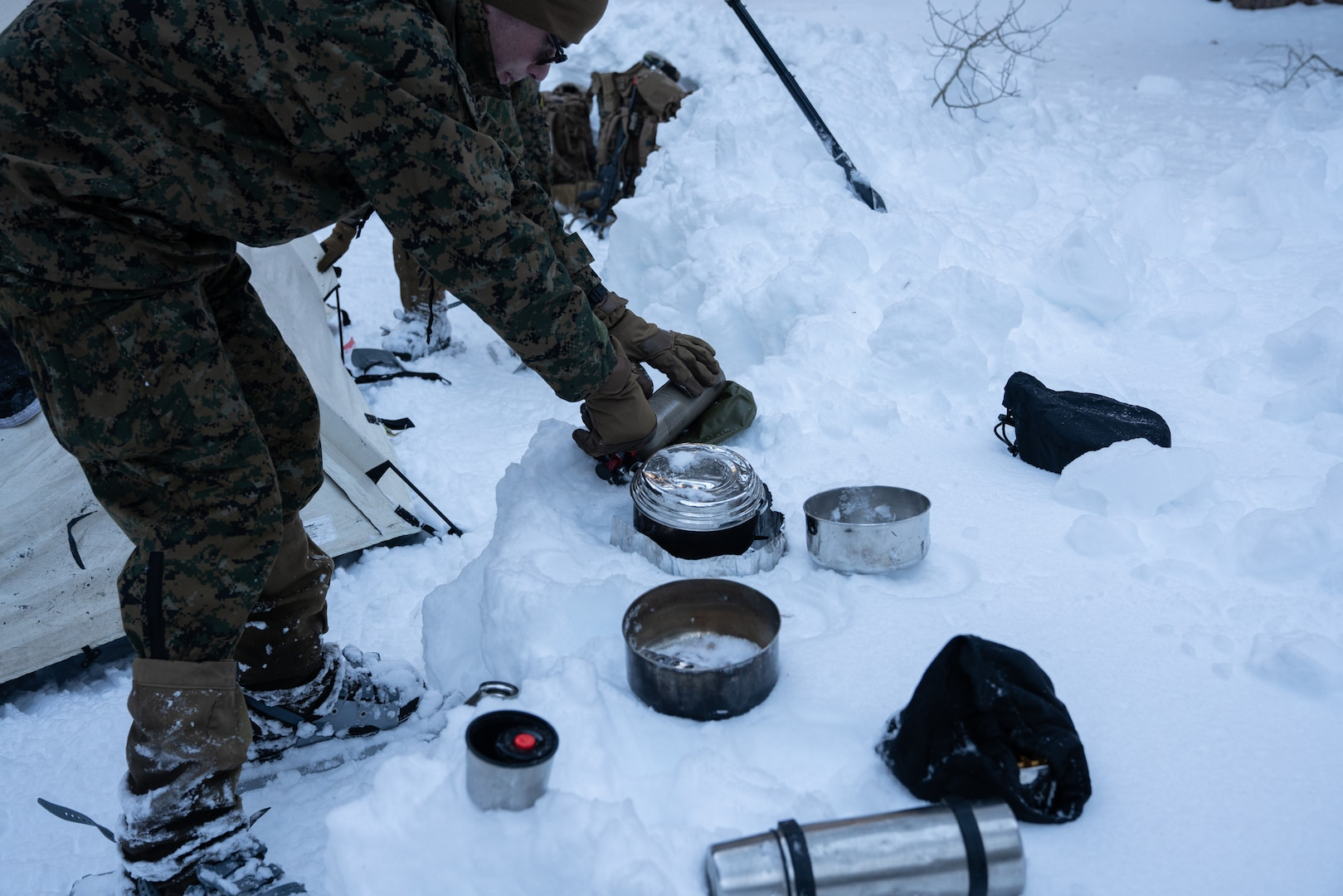 A Marine with 2nd Battalion, 7th Marines turns on a white gas stove while melting snow at the Mountain Warfare Training Center, on January 30, 2021. Marines participated in the Mountain Training Exercise, which prepares units for offensive operations in mountainous environments. (U.S. Marine Corps photo by Lance Cpl. Andrew R. Bray)