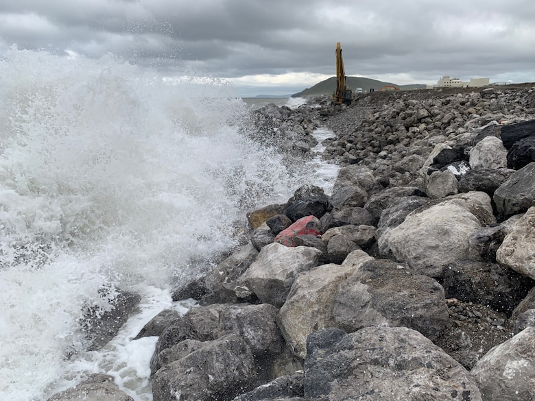 Waves batter the shoreline as crews work to repair the seawall at Cape Lisburne on Aug. 4, 2019.