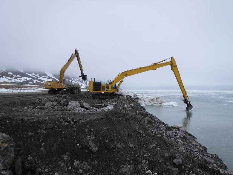 Crews work on the seawall as floating ice recedes at Cape Lisburne on May 23, 2020.
