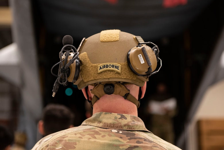 A photo of an Airman watching a demonstration.