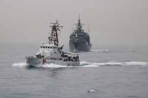 U.S. Coast Guard patrol boat USCGC Maui (WPB 1304) and Greek guided-missile frigate HS Hydra (F452) participate in a passing exercise in the Arabian Gulf, Feb. 25.  U.S. Coast Guard Patrol Forces Southwest Asia (PATFORSWA) is comprised of six 110' cutters, the Maritime Engagement Team, shore side support personnel, and is the Coast Guard's largest unit outside of the U.S. playing a key role in supporting Navy security cooperation, maritime security, and maritime infrastructure protection operations in the U.S. 5th Fleet area of operations.