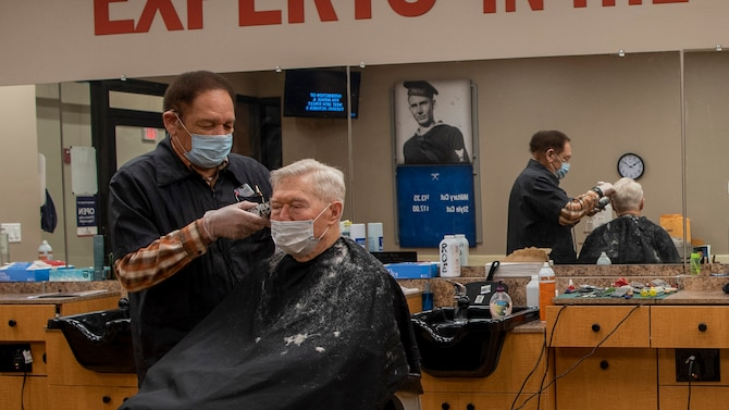 Richard Roe cuts the hair of a customer Feb. 5 at the Wright-Patterson Air Force Base Barber Shop. Meeting new people and being around the Air Force has kept him coming back to work for more than four decades, he says. (U.S. Air Force photo/Airman 1st Class Alexandria Fulton)