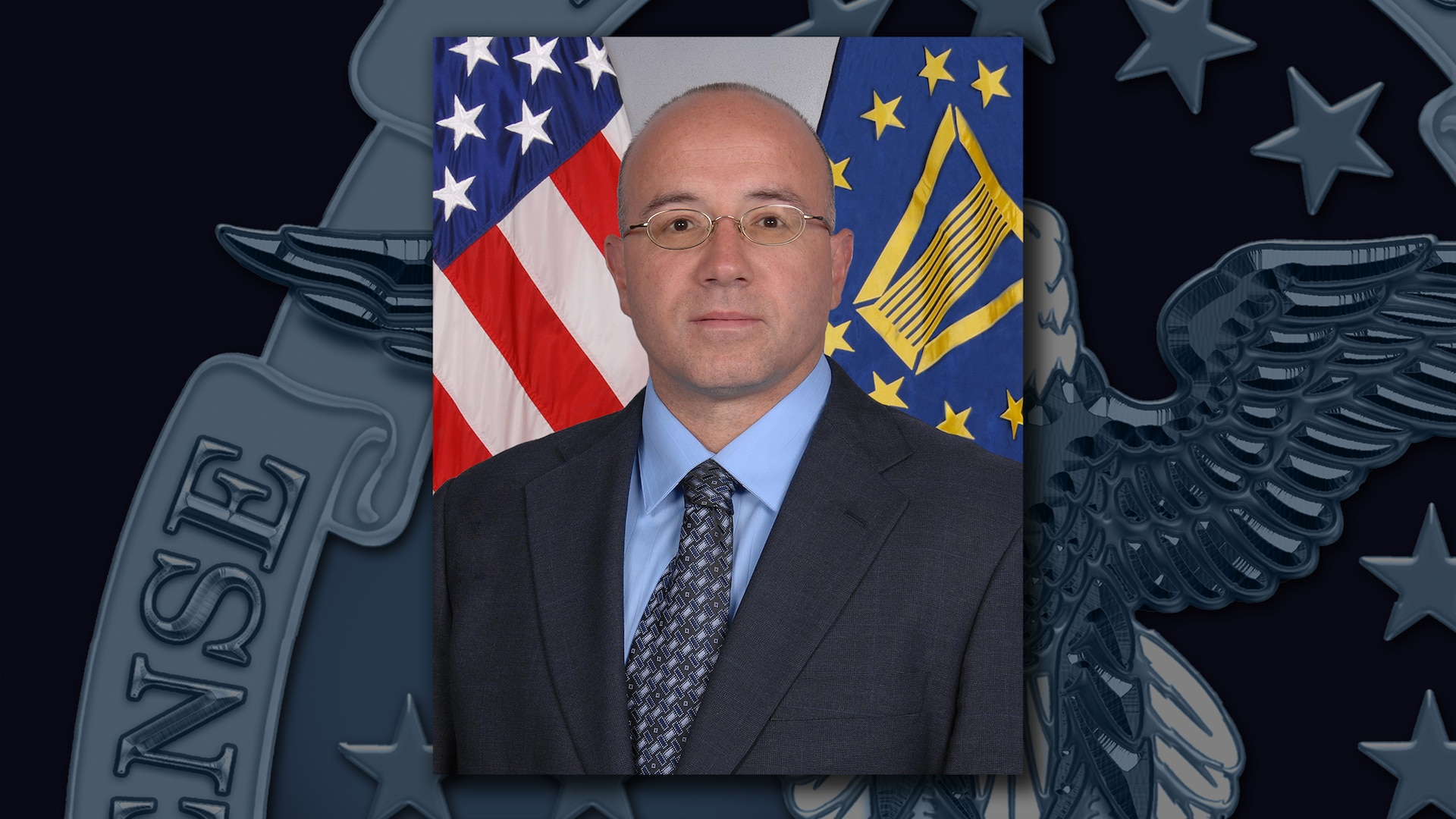 A portrait of Mike Scott on a DLA emblem background