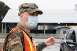 U.S. Army Spc. Carson Cato, an infantryman with the Cumming-based Alpha Company, 3rd Battalion, 121st Infantry Regiment, 48th Infantry Brigade Combat Team directs patients to receive COVID-19 vaccinations, Feb. 22, 2021, at a mass vaccination site in Clarkesville, Georgia. The Georgia National Guard is assisting Georgia Emergency Management and Homeland Security Agency at four COVID-19 mass vaccination sites across the state. (U.S. Army National Guard photo by Spc. Rydell Tomas)