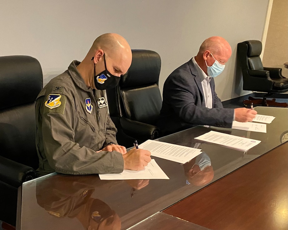 Col. Ryan Keeney, left, 49th Wing commander, and Jerrett Perry, Alamogordo Public School superintendent, sign a memorandum for Project SEARCH, Feb. 24, 2021, on Holloman Air Force Base, New Mexico. Project SEARCH is a high school transition-to-work program that serves young people with developmental disabilities to ensure successful transitions to productive adult life. (Courtesy photo)