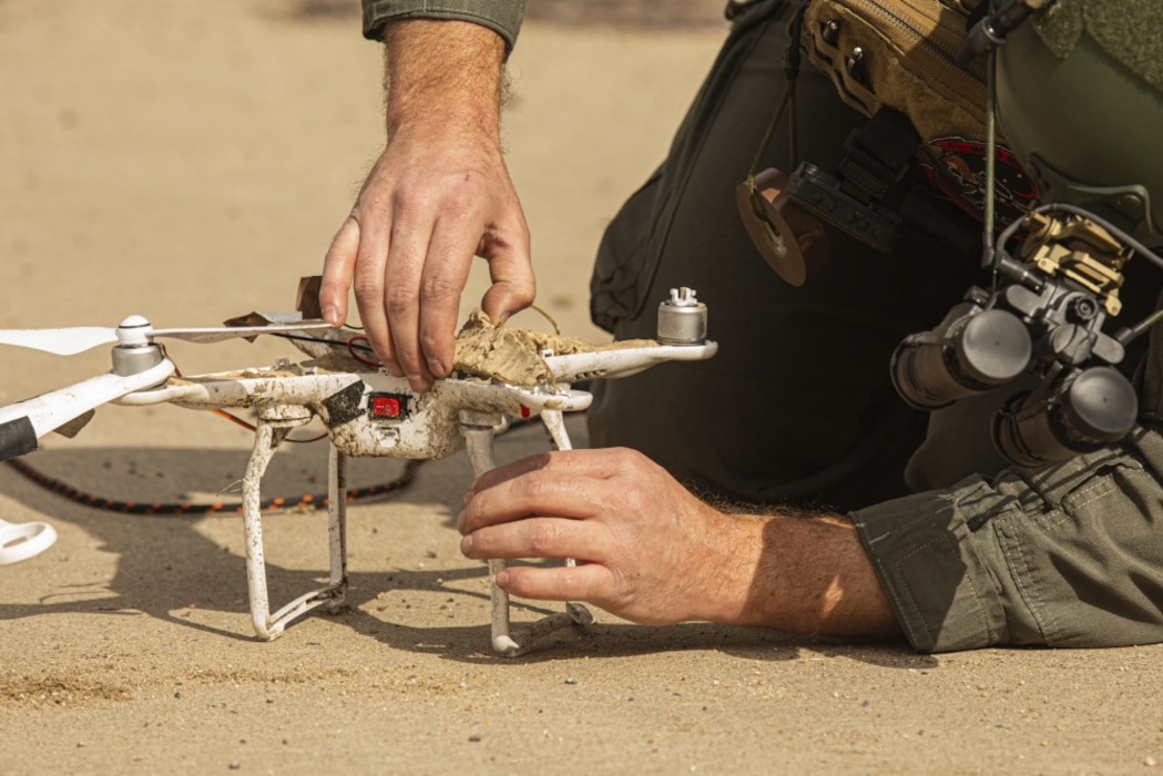 U.S. Marine Staff Sgt. Jeffrey B. Lysen, an explosive ordnance disposal Marine, takes apart a drone during a training event at Marine Corps Air Station Miramar, San Diego, California, Feb. 10, 2021. The EOD Marines with Headquarters and Headquarters Squadron train regularly to familiarize themselves with the proper disposal of explosives and maintain unit readiness. (U.S. Marine Corps photo by Lance Cpl. Jose S. GuerreroDeleon)