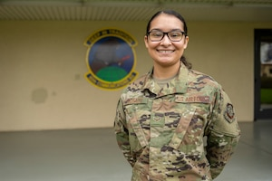 U.S. Airman 1st Class Thaila Delgado, 60th Communications Squadron knowledge management craftsman, poses for a photo Feb. 18, 2020, at Travis Air Force Base, California. Delgado drafted and coordinated with multiple base agencies to create a site that helps Airmen line up their budgeting, in efforts to help them move out of the base dorms more easily. (U.S. Air Force photo by Senior Airman Cameron Otte)