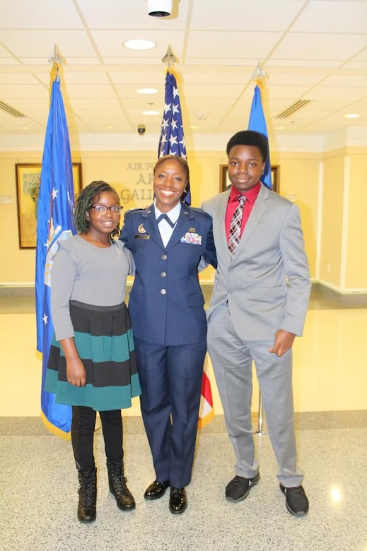Lt. Col. Miriam Carter, 459th Force Support Squadron commander, poses for a photo with her children Jeremiah and Allie during her promotion ceremony at the Pentagon, September 2018. (Courtesy Photo)