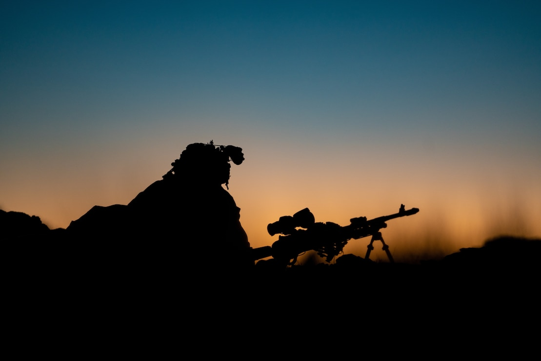 A Marine holds security with an M240B Medium Machine Gun while defending a checkpoint at the Marine Corps Air Ground Combat Center, Twentynine Palms, Feb,17.