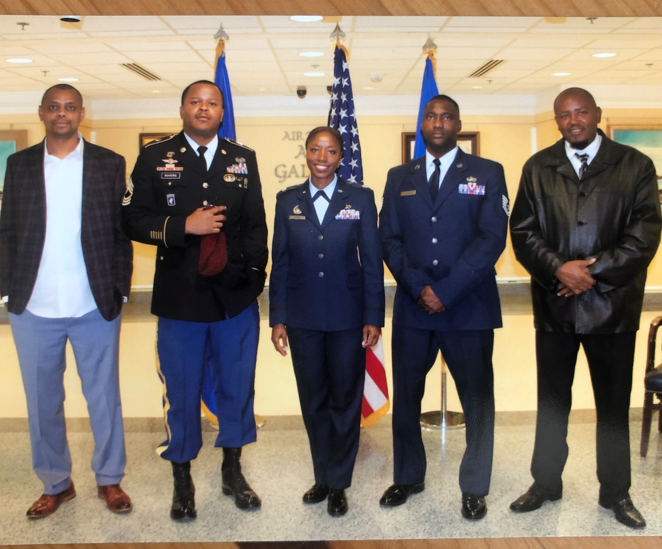 Lt. Col. Miriam Carter poses for a photo with her brothers (from left to right) Gerod Baldeo, MSG Ephraim Rivers, TSgt Collinsworth Ayers and Solomon Rivers during her promotion ceremony at the Pentagon, September 2018. (Courtesy Photo)