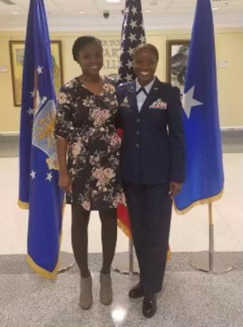 Lt. Col. Miriam Carter, 459th Force Support Squadron commander, poses for a photo with her sister Andrea Ayers during her promotion ceremony at the Pentagon, September 2018. (Courtesy Photo