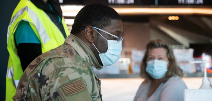 U.S. Air Force Airman Johnnie Boggs of the 175th Medical Group works at a computer terminal entering a patient's information before they receive the COVID-19 vaccine at M&T Bank Stadium in Baltimore, Md., Feb. 25, 2021. The Maryland National Guard is supporting Maryland's COVID-19 vaccination initiative.