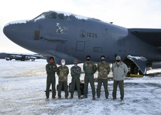 Honorable Sean Sipma, mayor of Minot, North Dakota, Lt. Colonel Brad Haynes, 5th Operations Support Squadron commander, and the flight crew pose in front of a B-52 Feb. 24, 2021 at Minot Air Force Base, North Dakota. Minot AFB often gives incentive flights to strengthen relationships between Team Minot and Minot township.
