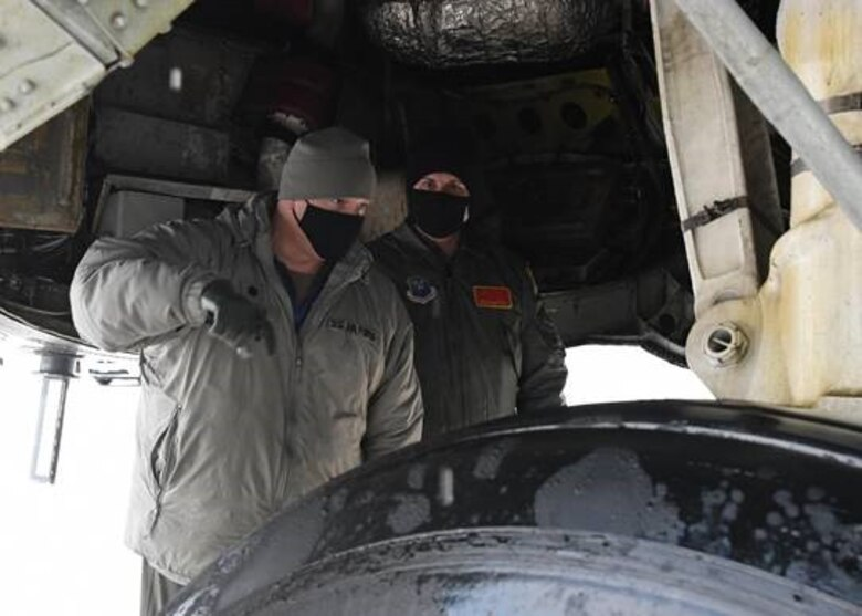 Honorable Sean Sipma, mayor of Minot, North Dakota and Lt. Colonel Brad Haynes, 5th Operations Support Squadron commander, perform preflight inspections of a B-52 Feb. 24, 2021 at Minot Air Force Base, North Dakota. Minot AFB often gives incentive flights to strengthen relationships between Team Minot and Minot township.