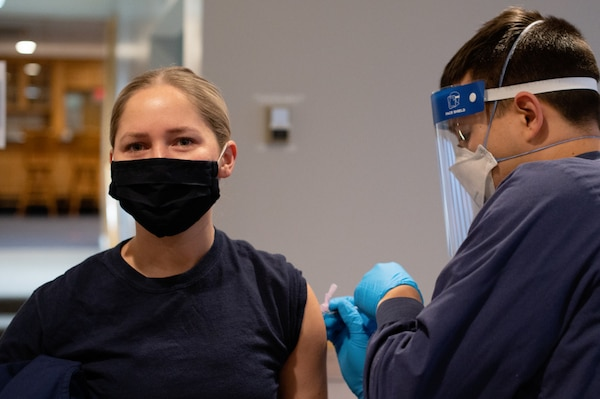 Coast Guard service members receive their initial dose of the Pfizer-BioNTech COVID-19 vaccine at U.S. Coast Guard Training Center Cape May, N.J., Jan. 8, 2021.