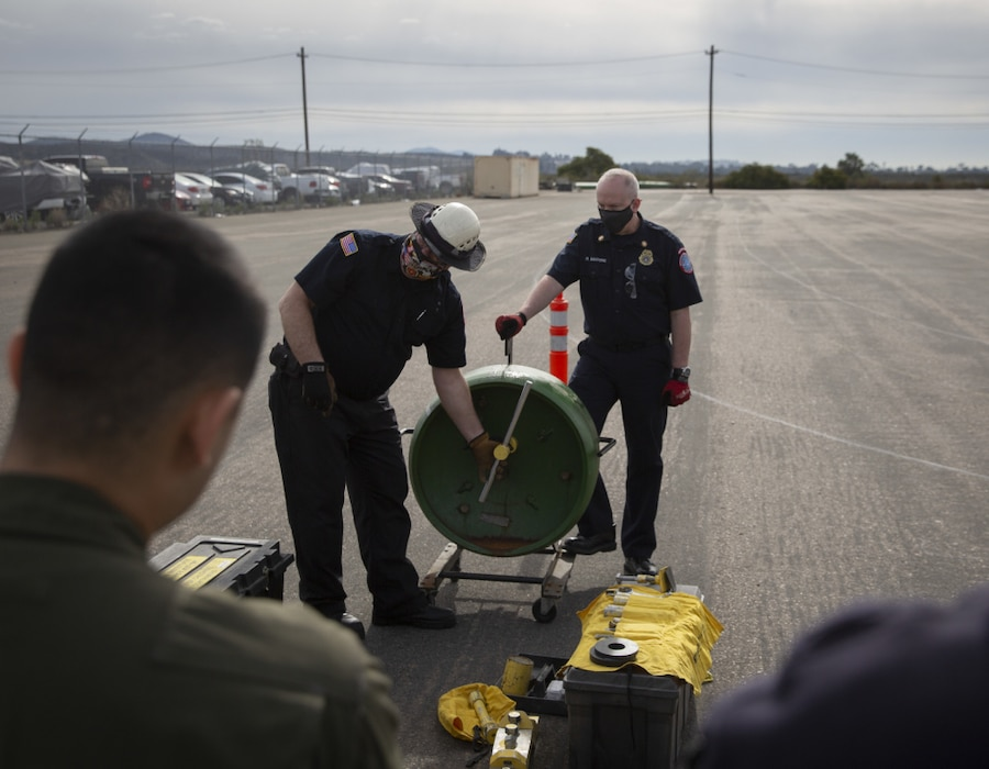 Aircraft Rescue and Firefighting Marines with Headquarters and Headquarters Squadron, Marine Corps Air Station Miramar, and firefighters with the MCAS Miramar Fire Department conduct hazardous materials training at MCAS Miramar, San Diego, California, Feb. 1, 2021. The training reinforced MCAS Miramar's readiness incase of a HAZMAT emergency. (U.S. Marine Corps photo by Lance Cpl. Krysten Houk)