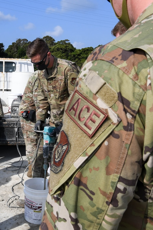 U.S. Air Force Senior Airman Hayden McAbee, an F-15 avionics technician from the 44th Aircraft Maintenance Unit, mixes mortar for expedient spall repair during a Multi-Capable Airmen course exercise, at Kadena Air Base, Japan, Feb. 25, 2021. Expedient spall repair quickly repairs holes enabling jets to continue to use the airfield.