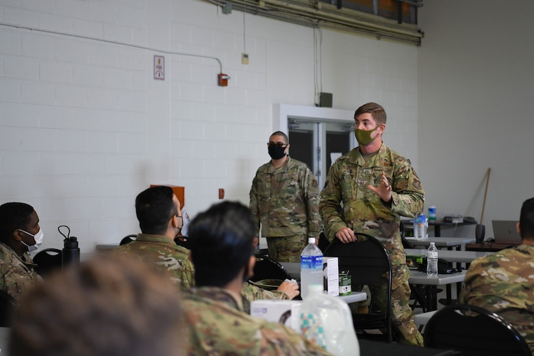 U.S. Air Force Master Sgt. Tyler Pillmore, the Agile Combat Employment section chief from the 18th Wing, briefs the Multi-Capable Airmen course participants on the next scheduled training at Kadena Air Base, Japan, Feb. 25, 2021. The MCA course broadens Airmen's skills beyond their current Air Force specialty code, supporting the Agile Combat Employment concept.