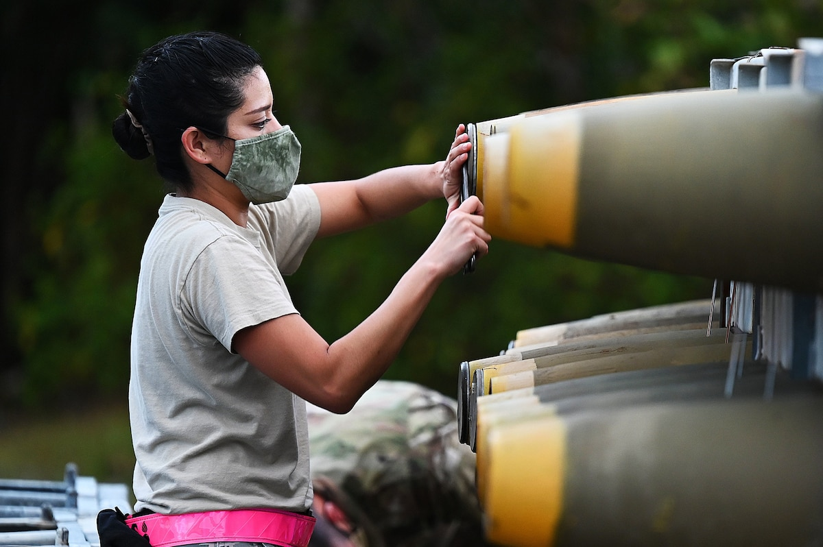 An airman works on a munition.