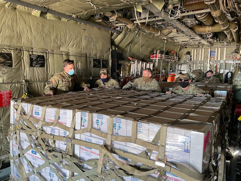 Airmen from the Kentucky Air National Guard deliver relief supplies to Abilene, Texas Feb. 23, 2021,  following a winter storm that left millions without electricity or potable water for days. The supplies, flown aboard a C-130 Hercules aircraft from the Louisville, Kentucky-based 123rd Airlift Wing, include food and bottled water. (U.S. Air National Guard photo)