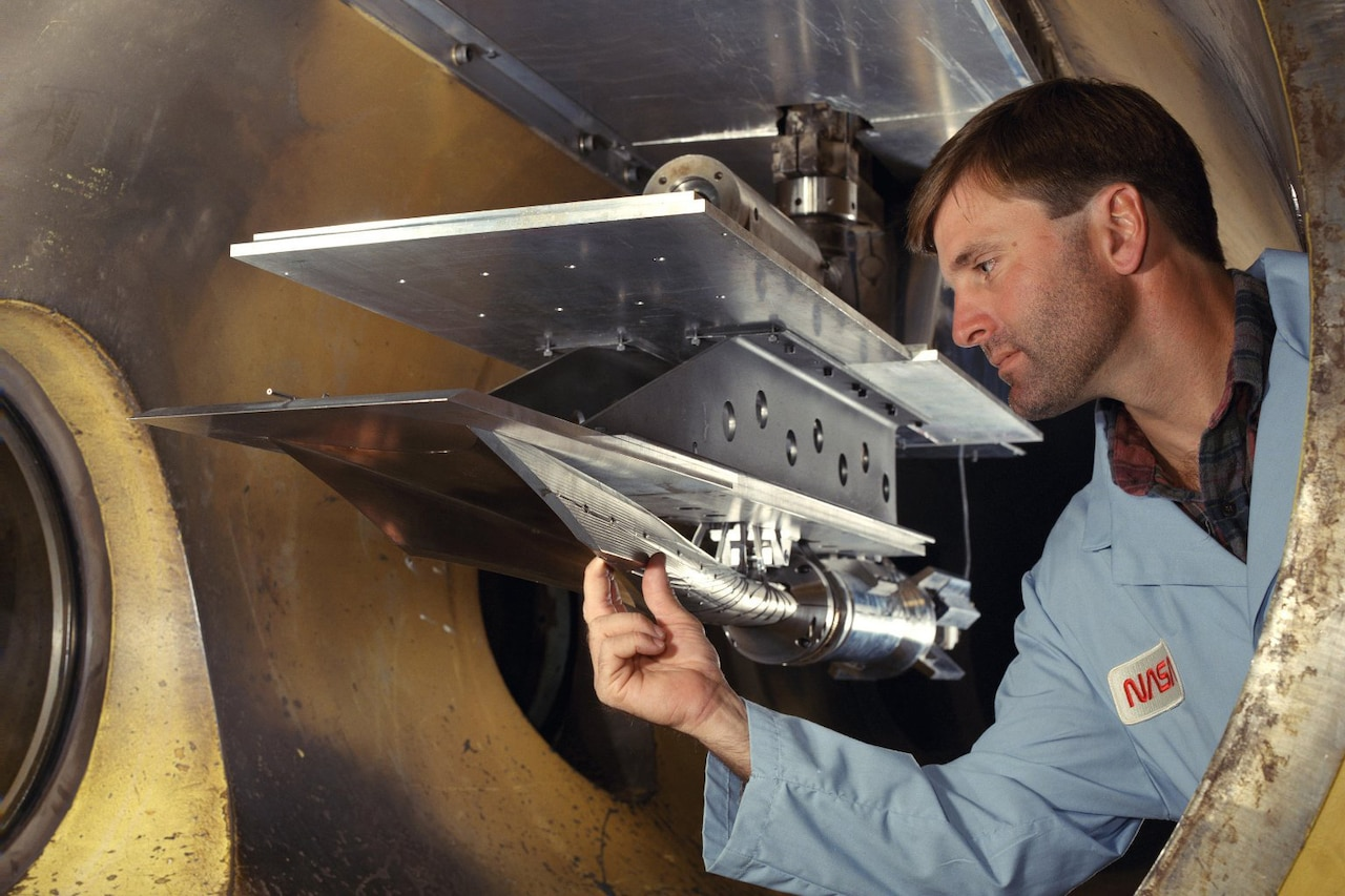 An engineer works on a hypersonic vehicle.