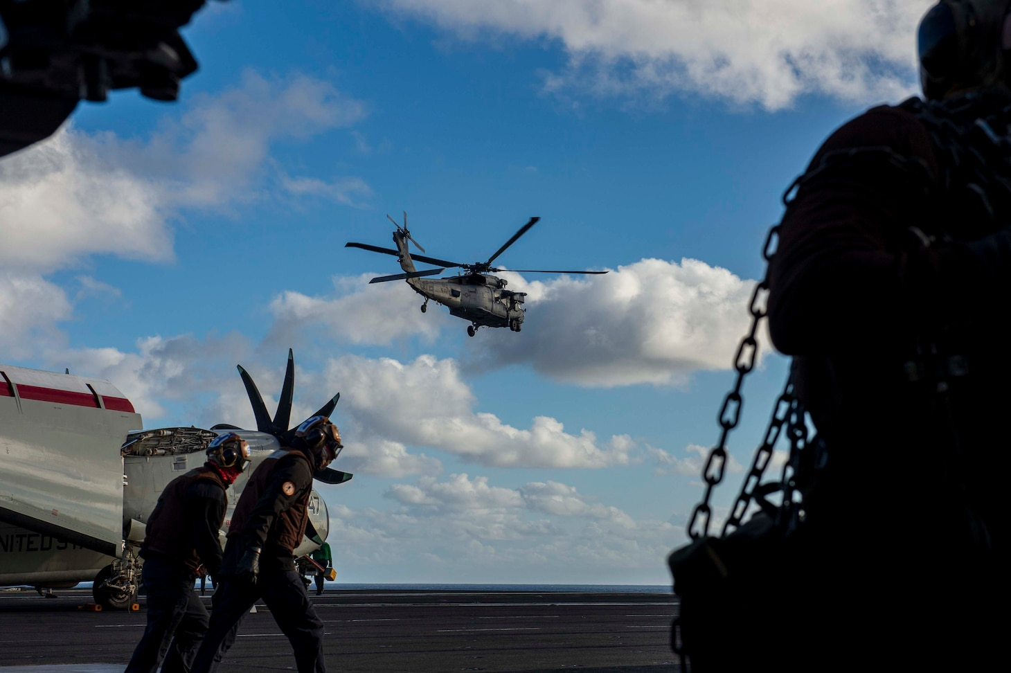 """210228-N-OB471-1016 ATLANTIC OCEAN (Feb. 28, 2021) An MH-60S Sea Hawk, attached to the """"Dusty Dogs"""" of Helicopter Sea Combat Squadron (HSC) 7, takes off from the flight deck aboard the Nimitz-class aircraft carrier USS Dwight D. Eisenhower (CVN 69), in the Atlantic Ocean, February 28, 2021. Ike is on a routine deployment supporting U.S. national security interests in Europe and increasing theater cooperation and forward naval presence in the U.S. 6th fleet area of operations. (U.S. Navy photo by Mass Communication Specialist Seaman Jacob Hilgendorf/Released)"""