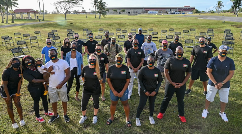 """Members of the Black History Month committee pose for a group photo prior to the start of their unity event at Andersen Air Force Base, Guam, Feb. 27, 2021. The event focused on this year's message """"The black family: Representation, Identity, And Diversity"""". Guests heard stories from volunteers, participated in a unity walk and played games aimed at bringing service members and families together to remember, recognize, and celebrate Black History Month ."""