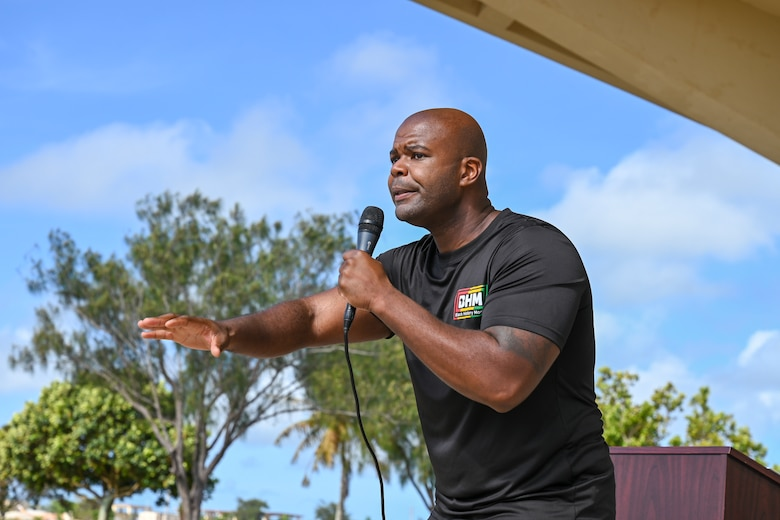 """U.S. Air Force Major Alexander Brown, 36th Healthcare Operations Squadron flight commander expresses his thoughts through spoken word during Andersen Air Force Base Guam's, Black History Month unity event Feb. 27, 2021. The event focused on this year's message """"The black family: Representation, Identity, And Diversity"""". Guests heard stories from volunteers, participated in a unity walk and played games aimed at bringing service members and families together to remember, recognize, and celebrate Black History Month."""