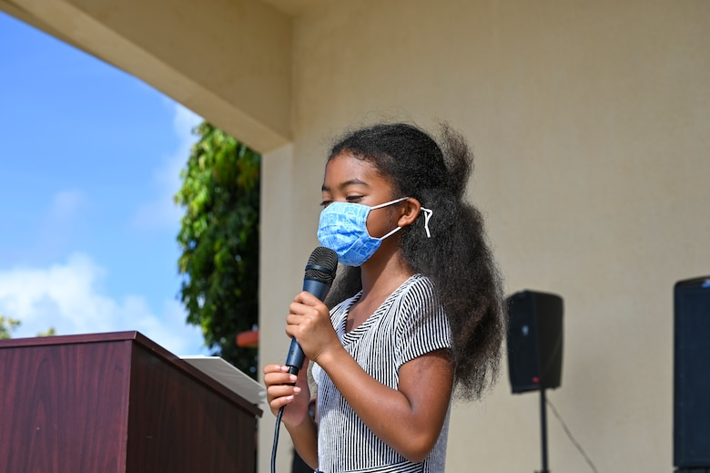 """Zoe Landry, a 4th grader from Andersen Elementary School, sings a song during a Black History Month unity event at Andersen Air Force Base, Guam, Feb. 27, 2021. The event focused on this year's message """"The black family: Representation, Identity, And Diversity"""". Guests heard stories from volunteers, participated in a unity walk and played games aimed at bringing service members and families together to remember, recognize, and celebrate Black History Month."""