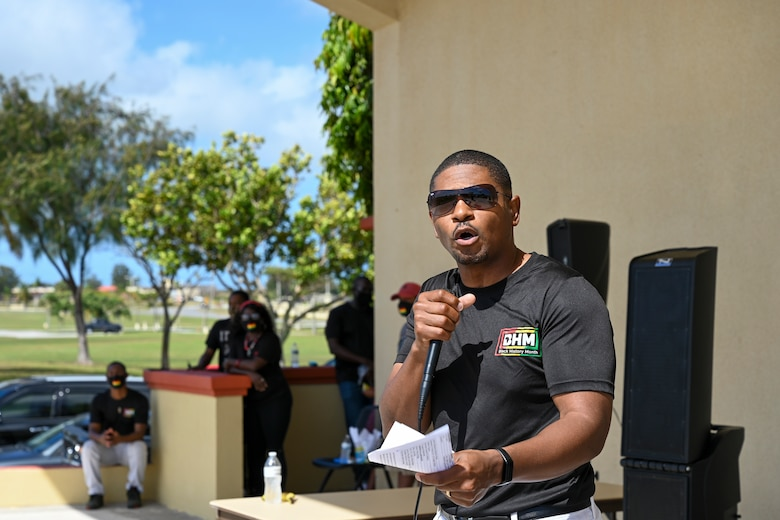 """U.S. Air Force Senior Master Sgt. Benny Dixon, 644th Combat Communications Squadron, chief special missions flight, shares his thoughts on Black History Month during a unity event at Andersen Air Force Base, Guam, Feb. 27, 2021. The event focused on this year's message """"The black family: Representation, Identity, And Diversity"""". Guests heard stories from volunteers, participated in a unity walk and played games aimed at bringing service members and families together to remember, recognize, and celebrate Black History Month."""