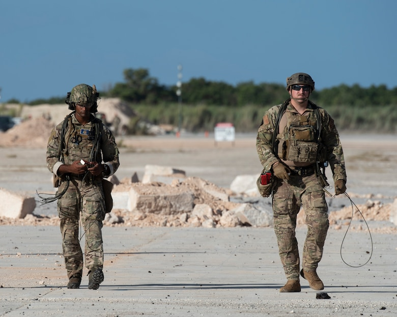 Airmen with the 554th RED HORSE Squadron prep an Airfield for repair during a Rapid Airfield Damage Repair (RADR) Exercise at Andersen Air Force Base