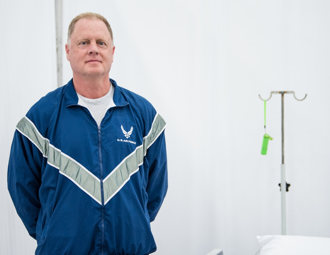 Maj. Anthony Gardner, a clinical nurse manager at the Louisville VA Medical Center, left his civilian employment to serve as the chief nurse for the 123rd Medical Group Detachment 1 at the Kentucky Fair and Exposition Center in Louisville, Ky., April 13, 2020. Gardner is currently working at an alternate care facility here. The facility is designed to assist patients recovering from COVID-19 should area hospitals reach capacity. (U.S. Air National Guard photo by Senior Airman Chloe Ochs)
