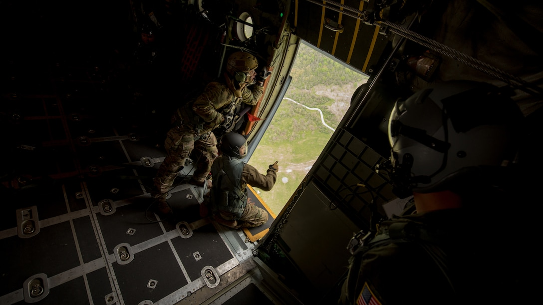 Pararescuemen and combat controllers from the Kentucky Air National Guard's 123rd Special Tactics Squadron prepare for a jump from a 123rd Airlift Wing C-130 Hercules during the Precision Jumpmaster Course held at Camp Atterbury, Ind., May 13, 2020. The course is an upgrade training class for students who have attended formal jumpmaster training before. (U.S. Air National Guard photo by Phil Speck)