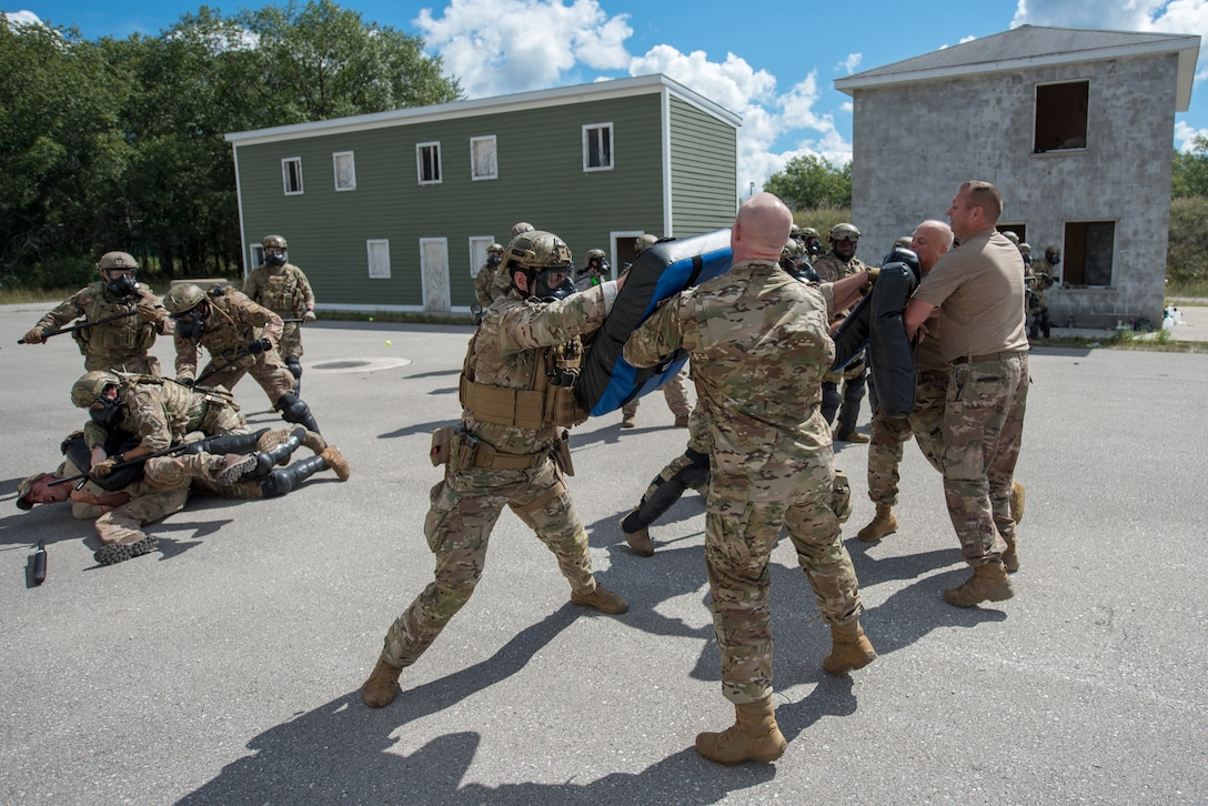 Members of the Kentucky Air National Guard's 123rd Security Forces Squadron practice riot-response skills in Alpena, Mich., Aug 19, 2020. The Airmen spent a week at Alpena Combat Readiness Training Center to prepare them for domestic operations and law enforcement assistance. (U.S. Air National Guard photo by Phil Speck)