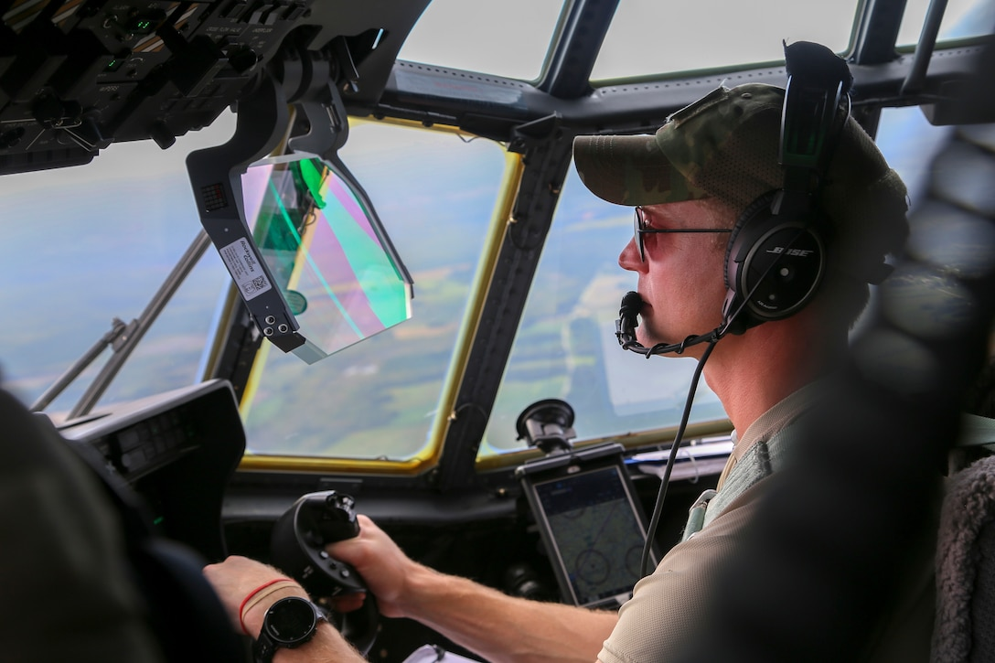 Alaska Air National Guard Capt. Matthew Soukup, a pilot with the 176th Wing's 211th Rescue Squadron, searches for isolated flood survivors aboard an HC-130J Combat King II aircraft while assisting with hurricane relief operations in North Carolina, Sept. 17, 2018.