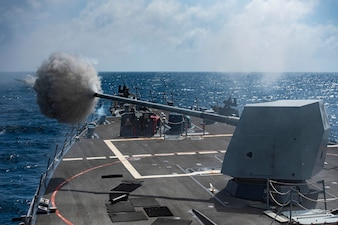 USS Sterett (DDG 104) fires its Mark 45 5-inch gun during a live-fire exercise.