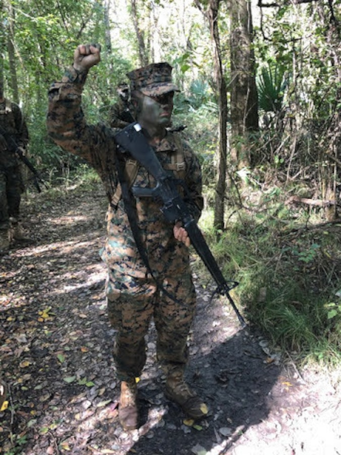 Midshipman 3rd Class Michael Johnson, a recipient of the Naval Reserve Officers Training Corps (NROTC) Scholarship and sophomore at Louisiana State University, participates in a field training exercise in Baton Rouge, Louisiana, Nov. 22, 2019.