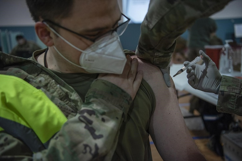 U.S. Air Force Maj. Gregory Baker, 86th Operational Medical Readiness Squadron medical director, receives an initial dose of the COVID-19 vaccine at Ramstein Air Base, Germany, Jan. 4, 2021. Ramstein was one of several overseas military treatment facilities with the capability to receive and distribute the vaccine. (U.S. Air Force photo by Senior Airman Jennifer Gonzales)