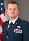 Photo of Airman posing for official photo