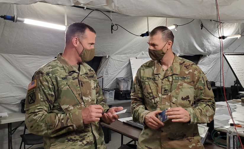 A first sergeant talks to another soldier