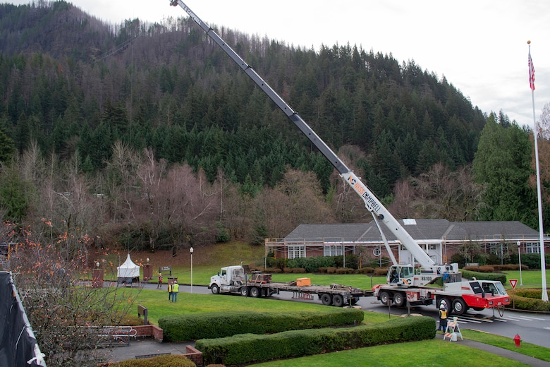 The crane conducts a safety test by lifting the new Auditorium cupola inches off the ground and suspending it for five minutes before placing it on the roof.