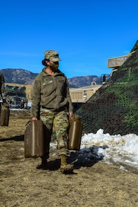 Soldier carrying fuel containers