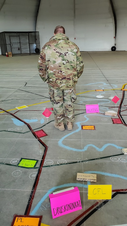 Soldier standing on map.