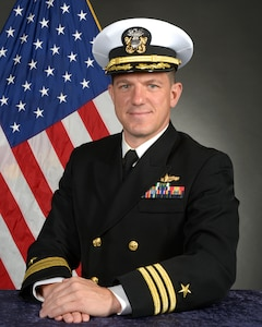 Studio portrait of Cmdr. Dominic J. Kramer