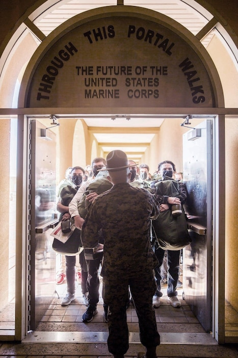 New recruits with Alpha Company, 1st Recruit Training Battalion, stand in formation during receiving at Marine Corps Recruit Depot, San Diego, Dec. 29, 2020.