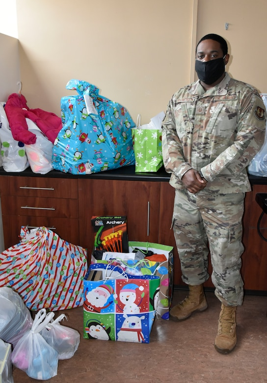 Master Sgt. Ricardo Hollingsworth stands with some of the gifts provided to area children by members of the Arnold Air Force Base workforce through the Arnold Engineering Development Complex Angel Tree program. This year, more than 200 children in surrounding counties were sponsored through the AEDC program. (U.S. Air Force photo by Bradley Hicks)