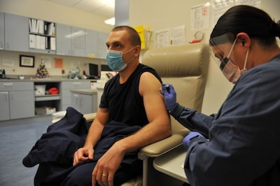 Service member receives vaccine