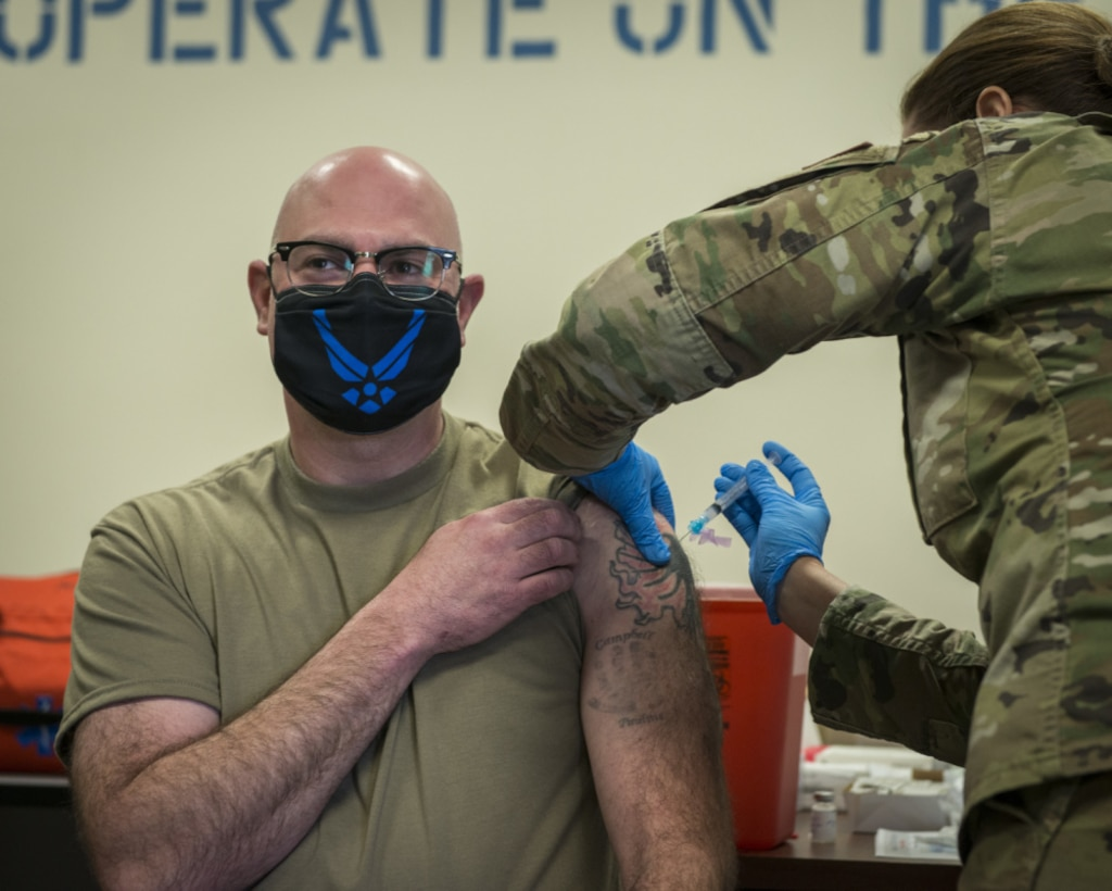 Lt. Col. Andy Kelly, 103rd Medical Group commander, receives the COVID-19 vaccine at Bradley Air National Guard Base in East Granby, Conn., Dec. 30, 2020. The Connecticut National Guard began administering the vaccine in accordance with the Department of Defense COVID-19 Vaccine Distribution Plan, with doses voluntarily administered to Soldiers and Airmen on the front lines of the COVID-19 pandemic response. (U.S. Air National Guard photo by Staff Sgt. Steven Tucker)