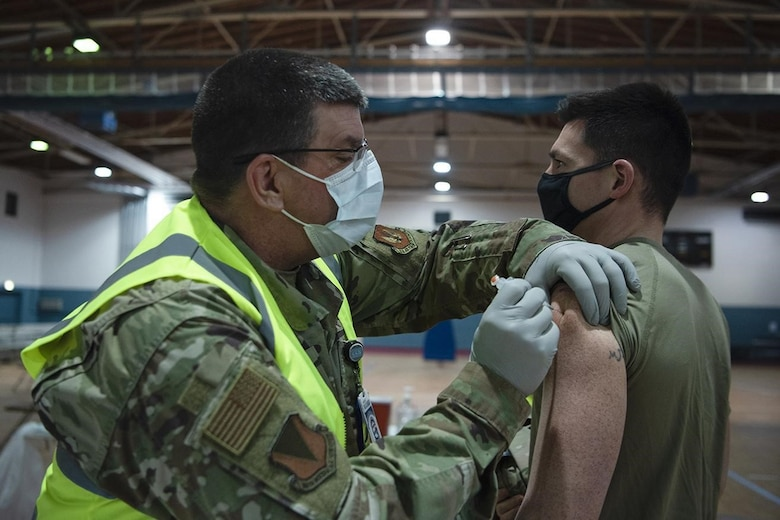 U.S. Air Force Capt. Christopher J. Gresham, 569th U.S. Forces Police Squadron operations officer, receives a COVID-19 vaccination at Ramstein Air Base, Germany, Jan. 4, 2021. Vaccine distribution is anticipated to continue over the next several months through a Defense Department-wide phased vaccination approach. (U.S. Air Force photo by Senior Airman Jennifer Gonzales)